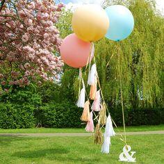 Giant round tasselled helium balloons in Powder by eagleeyedbride.com