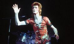 David Bowie performing as Ziggy Stardust at the Hammersmith Odeon, 1973.