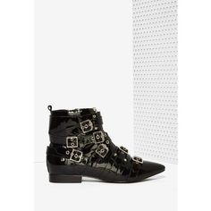 Jeffrey Campbell Phelan Patent Leather Bootie ($225) ❤ liked on Polyvore featuring shoes, boots, ankle booties, black, ankle boots, buckle ankle boots, black buckle boots, black boots and short boots