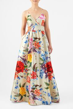 Our bold floral print polydupioni maxi dress is designed to flatter and enhance with a pleated surplice bodice, banded empire waist and a ruched pleat full skirt.