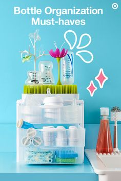 Keep your bottles and all their pieces together with a convenient countertop storage station. Start with clear, stackable storage bins to make finding everything easy. Add Baby's favorite bottles, like Dr. Brown's and Tommee Tippee. Both have vent systems and vacuum-free feeding to help with digestion (a must!). Top the bins with the Boon grass drying rack. Add accessories, like flowers and twigs, to add a little more drying space and a whole lot of cute. All are Target Baby Registry…