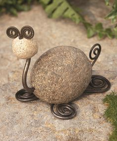 Bring a natural allure into your garden with this charming rock art.