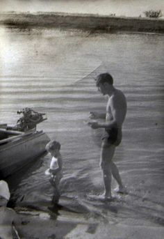 THE USSR. Siberian river Irtysh. Pavlodar. Romka small with his father.