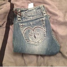 Rock Revival Bootcut Jeans Great jeans; not much stretch. Fit small for 28's. Great condition! Rock Revival Jeans Boot Cut