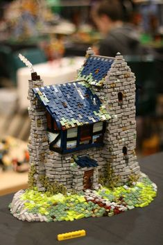 Heres a moc I built back in June, put it into a box to be sent to the Christchurch brickshow (where someone took this photo) and the box hasn't made it back to my place yet so this is the only photo I have of it. Not really in any rush to get it back (I've survived just fine with out it for the last 5 months) so not really sure when I'll take nice pics with clean background but for now here you go! This post may be updated later. Enjoy! David