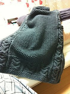free baby blanket pattern - ravelry - A jumping-off point, for the idea of a seed stitch blanket (reversible, simple pattern, more interesting than simple garter stitch) with a cable border (but I'd look to run it horizontally at top and bottom)