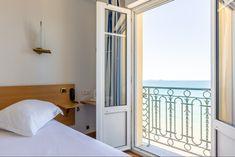 Chambre vue sur mer avec porte fenetre