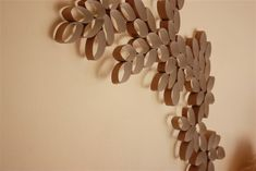 Toilet paper wall art!  Paint it or leave it plain, but a great reuse either way.