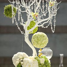 This whimsical yet sophisticated wedding had pomanders of flowers and string and circular IKEA rugs as an aisle runner.