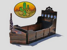 Sleeping can be fun...when you have a Pirate Ship Bed! Everything on this bed is handmade with details in mind. Headboard: rustic pine with