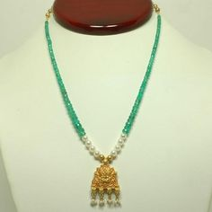 16 in. (40.6 cm) 41 ct. Emerald bead necklace with Chinese freshwater pearls, accompanied by a 18k & 22k yellow gold Kirti Maku pendant.