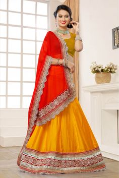 Art Silk Party Wear Lehenga Choli in Gold Colour.It comes with matching Blouse.It is crafted with Lace Work,Embroidery Design...