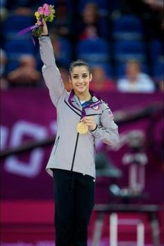 Aly Raisman and her gold medal for floor.