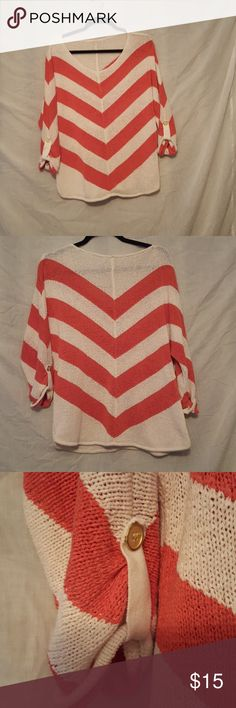 Chico's Chevron sweeter Good condition. Loose knit chevron sweater from chico's. I cut size out. Approx. Size Large. Color is like coral and off white chicos Sweaters