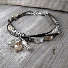 Intertwined leather & silver with rutilated quartz #handmade #jewelry #bracelet
