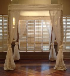 Modern Chuppah with Off-White Satin Top and Drapes over Maple Posts