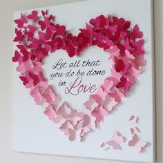 3D Butterfly Canvas Let all that you do be done in love in pink ombre shades. Hand painted quote with butterfly detail. Measures 20 x 20. This item is for decorative purposes ONLY. It is NOT a toy and SHOULD BE KEPT OUT OF REACH OF INFANTS AND CHILDREN. By purchasing this item, you