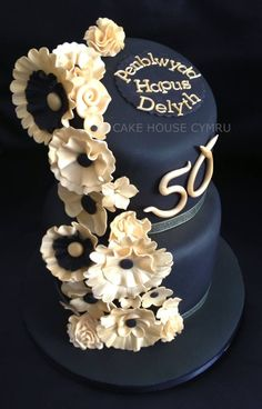 50th Birthday Cake - Black and gold tiered cake with fabric flowers