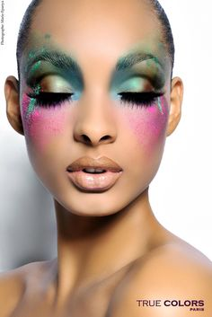 Advert for French makeup company True Colors Paris, photographed by Mario Epanya. Talk about mesmerizing eyes! Gorgeous color combination.