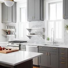 Charcoal Gray Kitchen Cabinets With Natural Brass Edgecliff Pulls