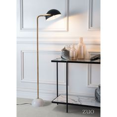 With a round marble base and long, linear stem, the Zuo Irving Floor Lamp provides a modern take on mid-century style. The black steel shade adjusts so you can direct light where you need it most, making it a smart choice for reading nooks. Light Bulb Wattage, Light Bulb Bases, Lamp Bases, Torchiere Floor Lamp, Brass Floor Lamp, Floor Lamps, Desk Lamp, Table Lamp, Floor Lamp With Shelves