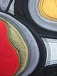 close up, Coral Bean Pod quilt by Jane Sassaman. Embroidered edges. May 2015.