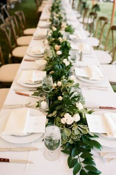 wooden farmhouse table is ideal for this style, but it still looks so pretty on white table linens