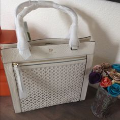 """Host PickKate spade off white bubbles bag Host Pick 7/28 make your mark posh fest 201513.7"""" h x 12.5"""" w x 5.3"""" d drop length: 8.3"""" MATERIAL perforated smooth cowhide leather with matching trim capital kate jacquard lining gold emboss with tiny cutout spade DETAILS shoulder bag with magnetic snap closure interior zip and double slide pockets exterior zip pocket NO TRADES. Please use the make an offer function as I do not negotiate in the comments. Thanks! kate spade Bags"""