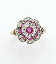A RUBY, DIAMOND, YELLOW AND WHITE GOLD RING