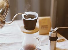 Pic: Hand drip coffee pouring water on coffee ground with filter dri