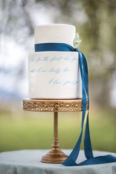 white #wedding cake with blue calligraphy