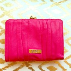 Bright pink Jessica Simpson wallet Fun and girly Jessica Simpson wallet.  Fold over wallet with 4 credit card slots, an ID viewer and change purse.  One nick on Inside upper left as noted in picture. Jessica Simpson Bags Wallets