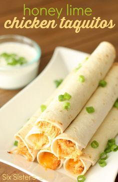 These Baked Honey Lime Chicken Taquitos from SixSistersStuff.com make a meal your entire family will love! #recipe #chicken #honey