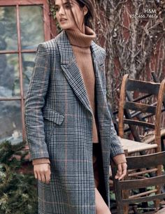 Blanca Padilla layers up in H&M plaid coat, turtleneck sweater and skirt