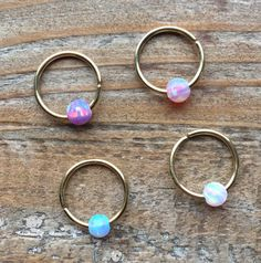 gold hoop ring with fire opal stone by LoveYi Cartilage Ring, Tragus Piercings, Body Piercings, Piercing Tattoo, Peircings, Septum Jewelry, Moonstone Jewelry, Hair Jewelry, Body Jewelry