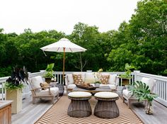 Treetop lounging in New York from this deck off Iris and Jay Dankner's master bedroom recall the trips to Belize that inspired its design.