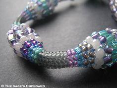 "Pastel Herringbone Bracelet with ""bobbles"" made by increasing & decreasing bead size.  Also link to basic twisted Herringbone rope.  ~ Seed Bead Tutorials"