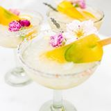 in case you didn't know, cocktail + popsicle = poptail 🍹 today on the blog we're sharing the recipe for one of our favorite creations of the summer so far… our spicy mango margarita poptail! as your popsicle melts into your margarita, it creates the most delicious flavor. go ahead… make a batch and see for yourself! 📸: @stodarophoto, 🍸: @thelittlemarket
