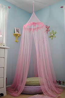 We have a canopy similar to this one but    now that Allana can stand up in her crib and reach for things it has become unsafe. This is a cool idea for when she gets a little older.