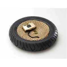 Tire and woven area to create a bowl or accent piece by TransNeomatic