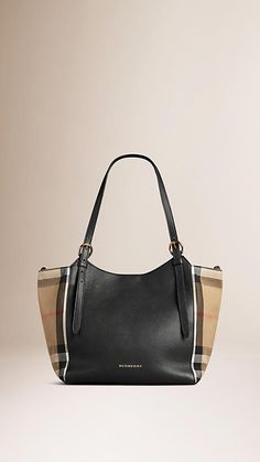 Burberry Black The Small Canter in Leather and House Check - A tote bag in grainy leather with side panels in House check cotton twill. Inspired by vintage designs, the bag features flat leather straps with equestrian buckles, while the open top closes with a stay fastening and magnetic press-stud. Discover the women's bags collection at Burberry.com