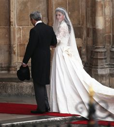 Kate takes one last look at the crowds before entering the Abbey on the arm of her father, Michael Middleton.