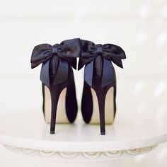 Formal Black Pumps with a Bow on the Back. The only place these satin, bow-tied beauties belong is in a ritzy venue accompanied by a classy cocktail.