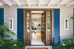 Accenting the home's Hamptons-style gray exterior, the white tongue-and-groove rafters double as a catwalk. The entry captures attention with a sculptural stairway that pulls the eye in and through the open living space to Naples Bay beyond. Blue Velvet Chairs, Florida Design, Grey Exterior, Open Space Living, Luxury Interior Design, Estate Homes, White Walls, Stairways, White Tongue