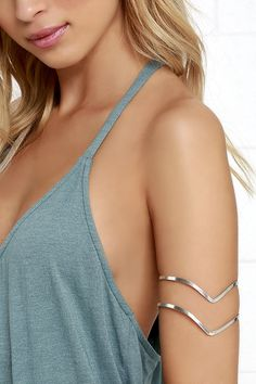 """You've got the tunes and the moves, now get the look with the Band Practice Silver Arm Cuff! Two pointed brushed silver bands join together to form this flexible arm cuff with a 3.25"""" diameter. Adjusts slightly."""