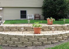 Lighting and light landscaping for the retaining wall in the backyard?