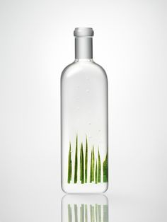"""Nendo created an exhibition featuring 20 clear bottles containing diorama that symbolizes a variation of the word """"rain"""" in Japanese."""