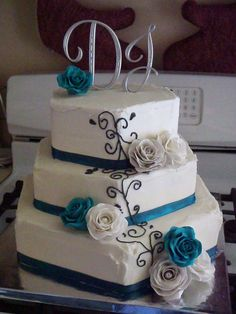 Buttercream Wedding cake with homemade gum paste Roses in Teal, Silver and White!