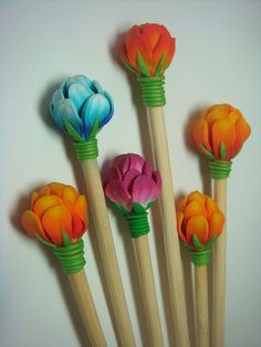 Beautiful Hair Pins by Ponsawan Sila ... what looks like polymer clay attached to simple bamboo (low cost bamboo chopsticks?) ... I just need to find this particular polymer flower tutorial :*)