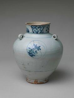 Jar with Four Ring Handles Period: early Edo period (1615–1868), Kanei era (1624–43) Culture: Japan Medium: Porcelain painted in underglaze blue (Arita ware, Imari type) Dimensions: H. 9 in. (22.9 cm); Diam. 7 5/8 in. (19.4 cm)